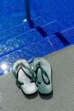 Green flip-flops at a pool Stock Photography