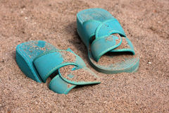 Green flip-flops on sand Royalty Free Stock Images