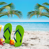 Green flip flops on the sand Royalty Free Stock Photo