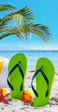 Green flip flops on the sand Royalty Free Stock Images