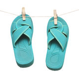 Green flipflops hanging on clotespin isolated Royalty Free Stock Images