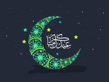 Green floral moon with Arabic text for Eid celebration. Royalty Free Stock Images