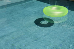 Green flotation ring. On a pool royalty free stock photos