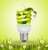 Green flourescent light bulb with leaves Royalty Free Stock Photos