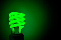 Green Flourescent Light Bulb. Typical compact flourescent light bulb in green color Stock Image