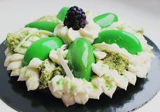Green flower cake with cream, microwave pistachio sponge and blackberry stock photography