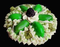 Green flower cake with cream, microwave pistachio sponge and blackberry on black royalty free stock photos