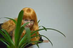 Green flower with sexy red-haired girl - Halloween Royalty Free Stock Images