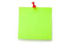 Green fluorescent sticker on red thumbtack. Placed on white background Stock Photos