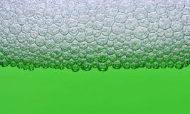 Green foam. Water with foam bubbles - green impression Stock Image