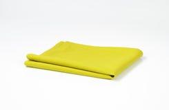 Green folded napkin. Folded green cloth napkin on white background Stock Photography