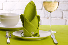 Green folded napkin. On plate for table set royalty free stock photography