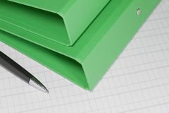 Green folders with pen Royalty Free Stock Photo