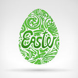 Green foliage easter egg graphics designed with text Royalty Free Stock Photo