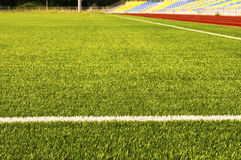 Green football field grass. Stadium Royalty Free Stock Image