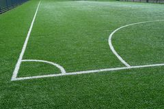 Green football field with white marking lines royalty free stock photos