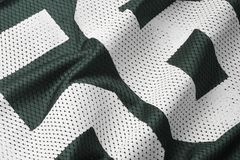 Green football Jersey. Close up shot of green textured football jersey with partial number Stock Images
