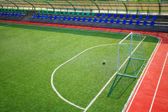 Green football soccer pitch stadium. With a ball near the gate Stock Images
