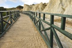 Green footbridge on sand dunes. royalty free stock photos