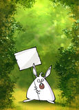 Green forest background with a protesting rabbit Stock Photography