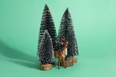 Green forest firs and reindeer Royalty Free Stock Image