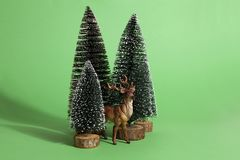 Green forest firs and reindeer Stock Image
