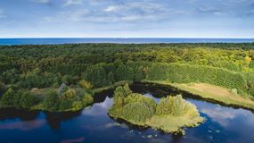 Free Green Forest Island And The Sea In Aerial View Stock Image - 132832611