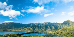 Green Forested Mountain Range Under Blue Sky With Clouds Stock Image