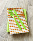 Green fork, knife and napkin on wooden royalty free stock photos