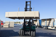 Green fork lifter truck and cargo box. Under sunlight Stock Photography