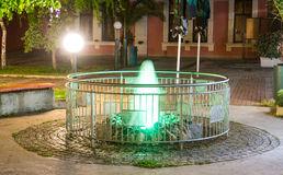 Green fountain in the center of the old part of the night Pomorie in Bulgaria Stock Photo