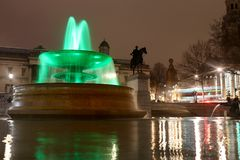 Green fountain for earth day with slow shutter speed at Trafalgar Square stock photos