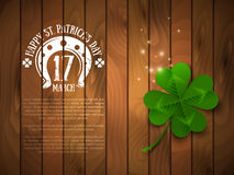 Green Four Leaf Clover on Wood Stock Photo