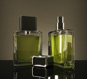 Green fragrance bottles. With reflections on dark background. 3D Rendering Royalty Free Stock Images
