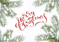 Green frame fir branches isolated on white background with text Merry Christmas. Lettering calligraphy Stock Photo