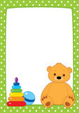 Green frame and toys. Vector light green frame with white dots. Brown teddy bear, stacking rings toy and ball. Place for text on a white background. Design for Royalty Free Stock Photos