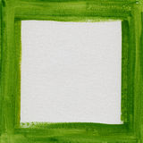 Green frame on white canvas Royalty Free Stock Images