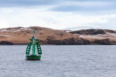 Green framed buoy with cone topmark royalty free stock image