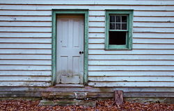 Door and window of old clapboard hou. Green trim window and door of old white abandoned clapboard house stock photography