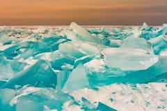 Green freeze breaking ice with sunrise. Skyline background royalty free stock image