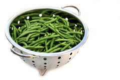 Green french beans. An isolated strainer filled with french beans Stock Photography