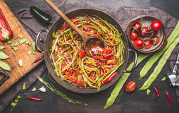 Green French beans meal preparation with wooden spoon. Royalty Free Stock Photography