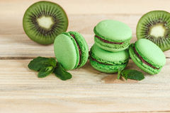 Green french macarons with kiwi and mint decorations Royalty Free Stock Photo