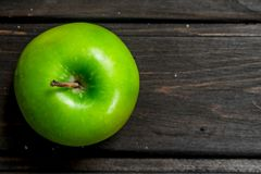 Green fresh Apple. On wooden background royalty free stock images