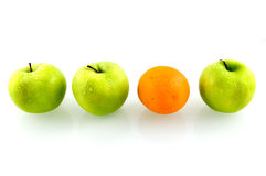 Green fresh apples with one orange Stock Photography