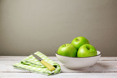 Green fresh apples on wooden table Royalty Free Stock Photo