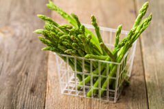 Green fresh asparagus in a plastic basket Royalty Free Stock Image