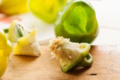 Green fresh bell peppers prepared for stuffing royalty free stock photography