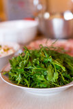Green fresh bunch of parsley and dill lying on the plate for decoration of dishes Stock Image