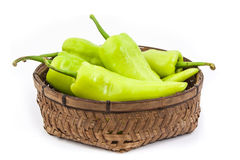 Green fresh capsicum vegetable in basket Royalty Free Stock Photography